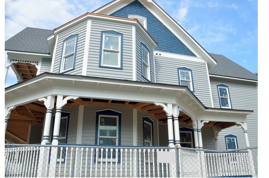 A Victorian home in Marquette, MI, with gray wood siding.